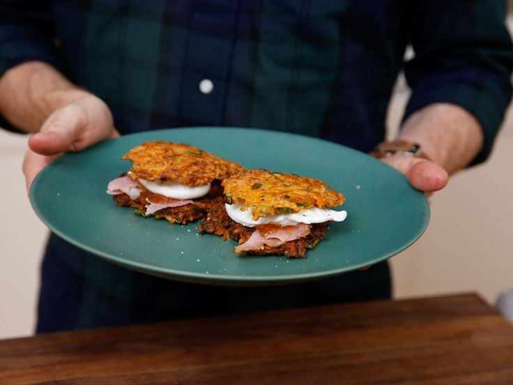 Sweet Potato-Green Onion Pancakes with Poached Eggs, Holiday Ham and Pepper Jam recipe from Bobby Flay via Food Network