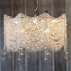 chandelier. that could be cool. just like some long things... like dowels.. connected at the middle with the hardware.. and then strings of crystals strung across them.