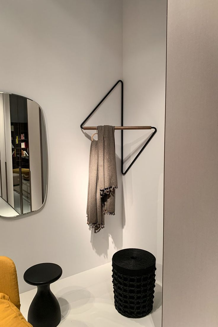 SMPDO (Simon Morasi Pipercic Design Office) has created Ugao, a minimalist clothes rack that's been designed to save space and neatly fit into the corner of a room.