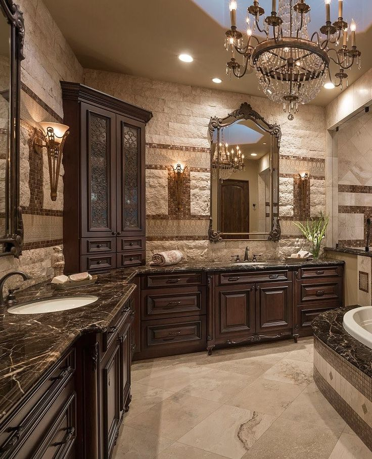 Stunning master bathroom with rich cabinetry and stone walls. #master #bathrooms homechanneltv.com