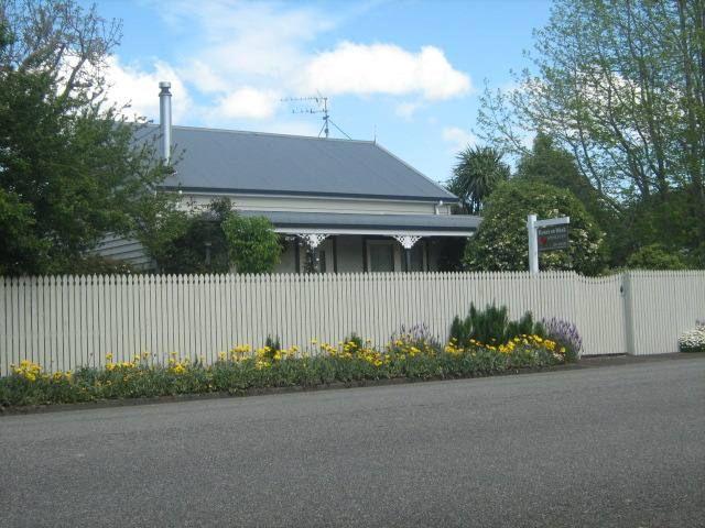 Roses On West Cottage