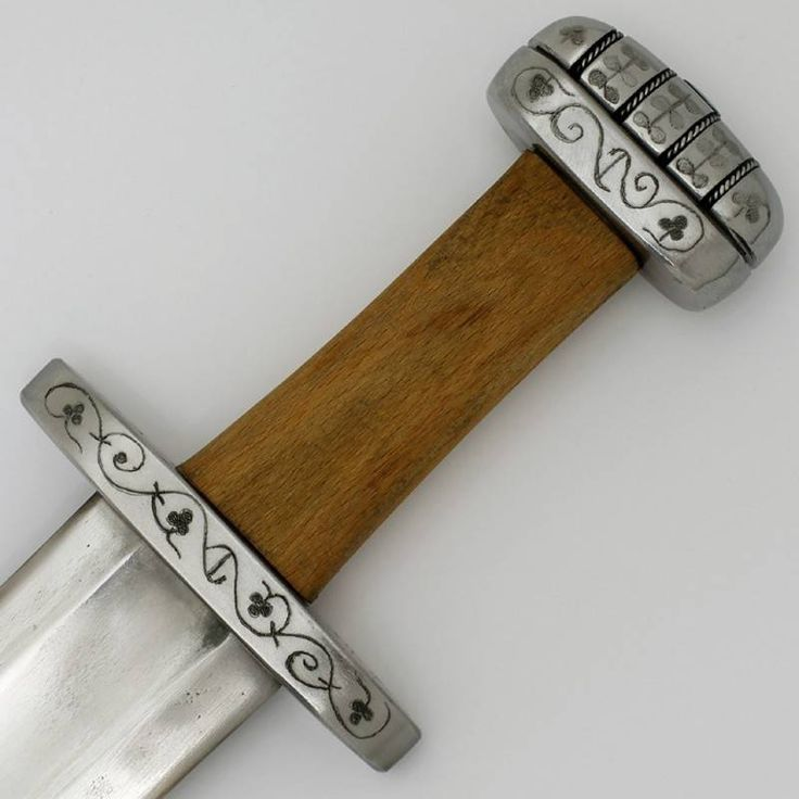 Celtic Britain Viking sword Ballinderry. The blade has a wide fuller and is engraved with the name +ULFBERHT+, refering to the Frankish smithy that made the original. The other side of the blade is engraved with the signs IXXXI, a decoration which is often found on Ulfberht`s blades.