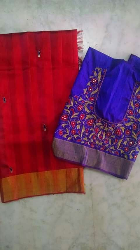 Red saree with blue buta and a blue embroidered blouse