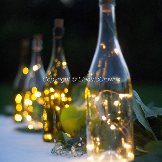 26 best wine bottle crafts centerpieces wedding images on for Wine bottle decoration with lights