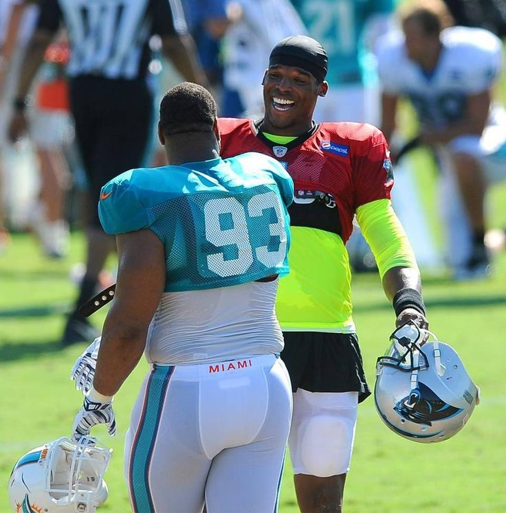 Carolina Panthers quarterback Cam Newton, right, jokes with Miami Dolphins defensive tackle Ndamukong Suh, left, during practice on Thursday, August 20, 2015. The Panthers hosted the Miami Dolphins in a joint practice at Wofford College in Spartanburg, SC.