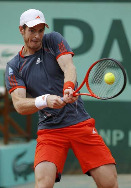 Britain's Andy Murray hits a return to Spain's David Ferrer during their men's quarterfinal tennis match of the French Open tennis tournament at the Roland Garros stadium, on June 6, 2012 in Paris.