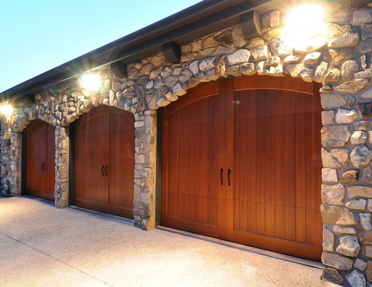 jay lenou0027s custom mahogany clopay reserve collection carriage house garage doors operated by hightech fingerprint access and a universal remote