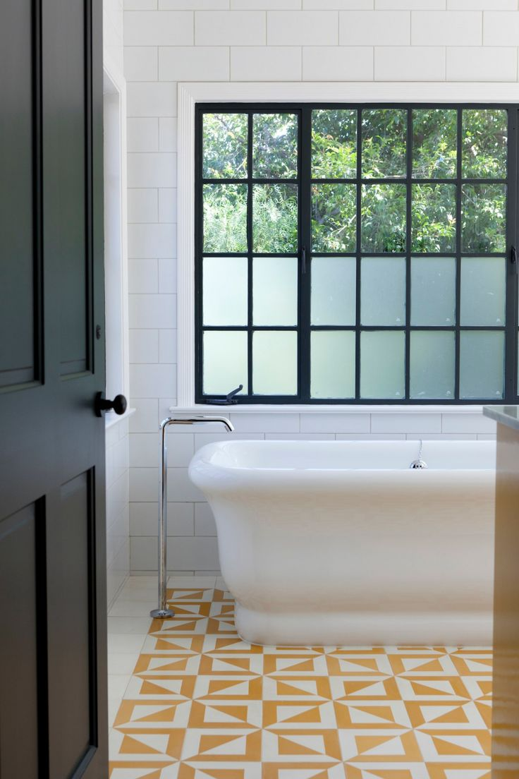 Tour A Bright, Fresh LA Family Home // Freestanding Modern Bathtub, Yellow  Geometric Tiles, Bathroom Floor Tiles