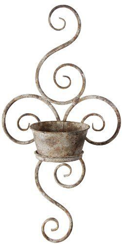 Esschert Design USA AM02 Aged Metal Wall Planter by Esschert Design USA. $24.99. Measures 19-1/2-inch H by 9.8-inch L by 5.1-inch W. Rustic aged metal finish. Beautiful scrolled design. Perfect displayed alone or in pairs. The aged metal finish of this wall planter is a perfect addition to your outside decor. The beautiful scrolled design will look great on any wall.