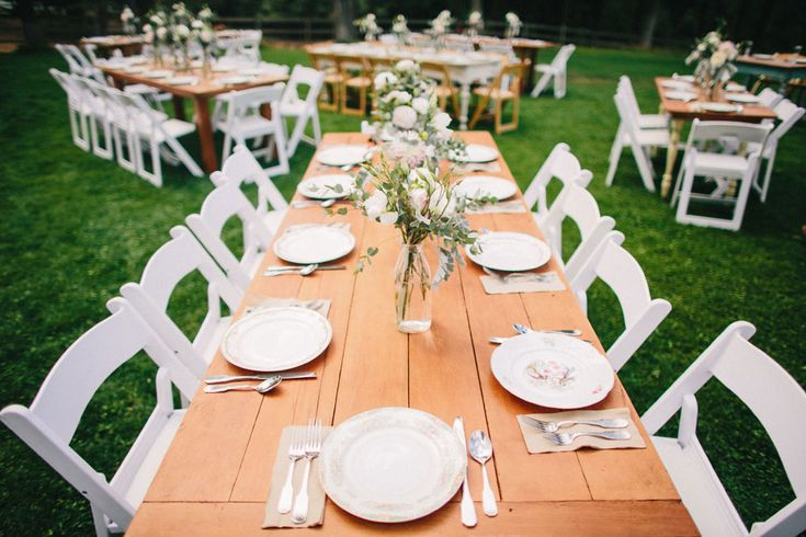 Mixed vintage natural wood tables, outdoor reception | Free-Spirited Cle Elum Ranch Wedding With Vintage Detailing | Photograph by Ryan Flynn Photography  http://storyboardwedding.com/free-spirited-cle-elum-ranch-wedding-vintage/