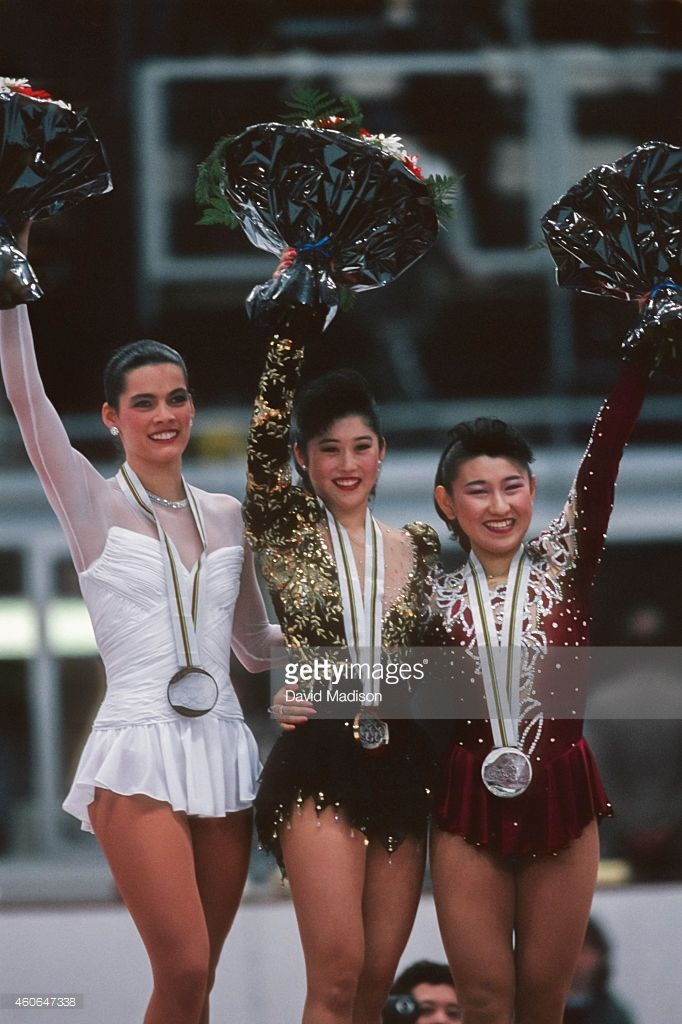 Nancy Kerrigan (USA) (left), Kristi Yamaguchi (USA) (center), and Midori Ito (JPN) (right) pose following the medal ceremony for Women's Singles event of the Figure Skating competition of the 1992 Winter Olympic Games held in Albertville, France on February 21, 1992.
