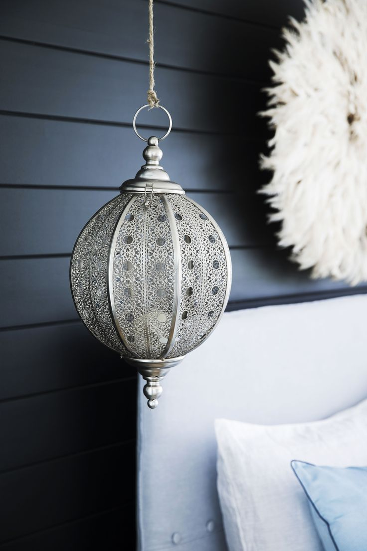 This bedroom is a blissful retreat, thanks to exotic touches such as the glimmering silver 'Filigree' hanging lantern.