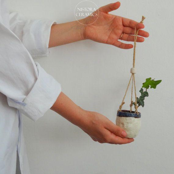 Handmade ceramic hanging planter in off-white snd blue