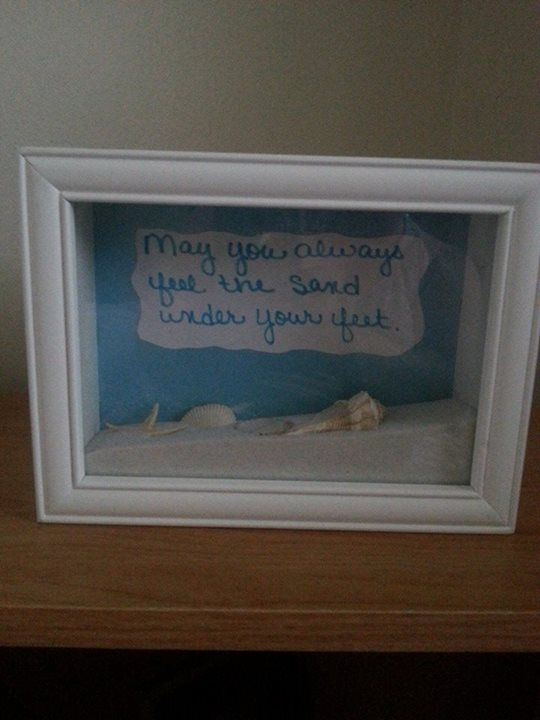 shadow box with sand and shells with quote