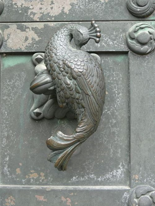 Beautiful peacock handle to Our Lady Maria Cathedral, Ribe, Jutland, Denmark.