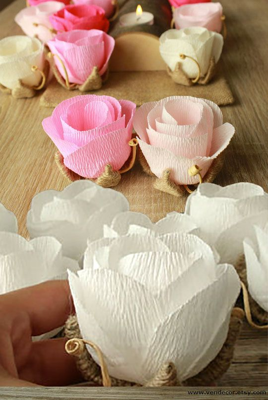 Cute and elegant rustic rose buds wedding decorations. They could be part of the centerpieces, scattered on table tops, or used as place cards The same artisan has a version that comes with name tags. Scroll to number 13 on the page.