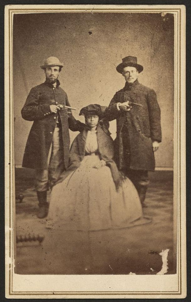"""This image is of a Kentucky runaway slave-woman who was escorted to freedom by the aid of two Wisconsin soldiers... They kept her in disguise as a """"mulatto soldier boy"""". After safely reaching Ohio, they took this image on Sep. 1862 in Cincinnati."""