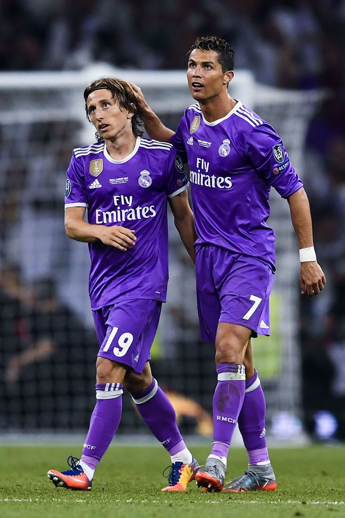 b1edc7215 ... Cristiano Ronaldo (R) of Real Madrid CF celebrates with his team mate Luka  Modric after scoring his team s third goal during the UEFA Champions League  ...