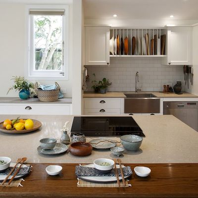 One of my favourite kitchens. Tepan-style, with the cooking on the island, this kitchen was designed for entertaining. Using Shitake benchtops from Caesarstone, this adds a warm touch to this not so traditional styled kitchen