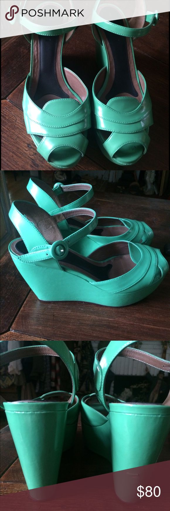 """MARNI patent green wedge sandals Reposhing these beauties because the heel height is too high for me. Selling at this price to make my money back. Very comfortable green wedges by MARNI. 4"""" wedge heel, 2"""" platform. Size 10, but can also fit a size 9.5. There's a small scuff/nick on the backside of one of the heels. This can be easily repaired by a cobbler. Retail value is over $700! Listing under Anthro for exposure. Marni Shoes Wedges"""