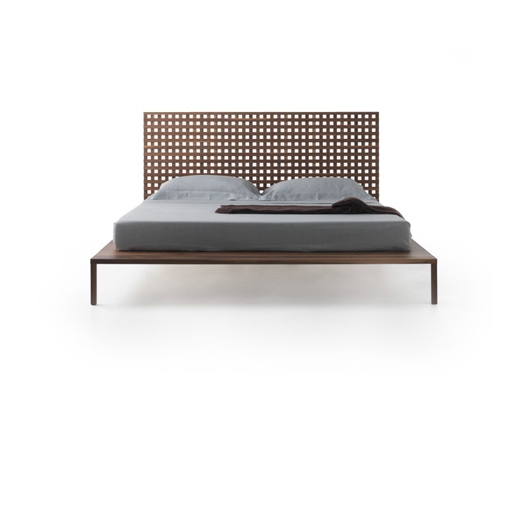 Horm Twine by Matteo Thun -       Completely made of solid walnut, Twine features a headboard made of orthogonal slats that creates a fine yet distinctive fretwork. The craftsmanship that enhances the clean design lines constitutes an essential element of this bed.