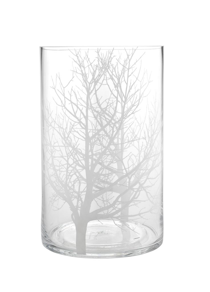 Patterned with tree branches, this glass hurricane candle holder has a peaceful and serene style. Priced at £10