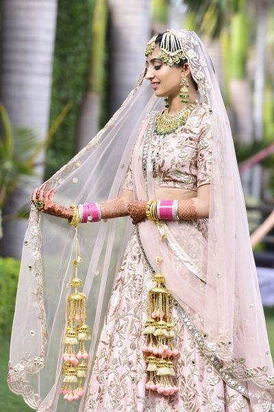 Bridal Lehenga - Bride in a Pink and Gold Lehenga with Gold Kaleere   Makeup by: Amanat Gill Makeup Artist #wedmegood #indianbride #bridallehenga #pink #gold #kaleere #weddinglehenga