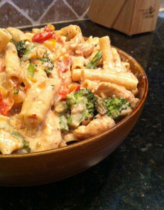 Confetti Chicken -- pasta, chicken, salt/pepper, onion, garlic, peppers, brocoli, asparagus, grape tomatoes in a cheesy, spicy sauce.