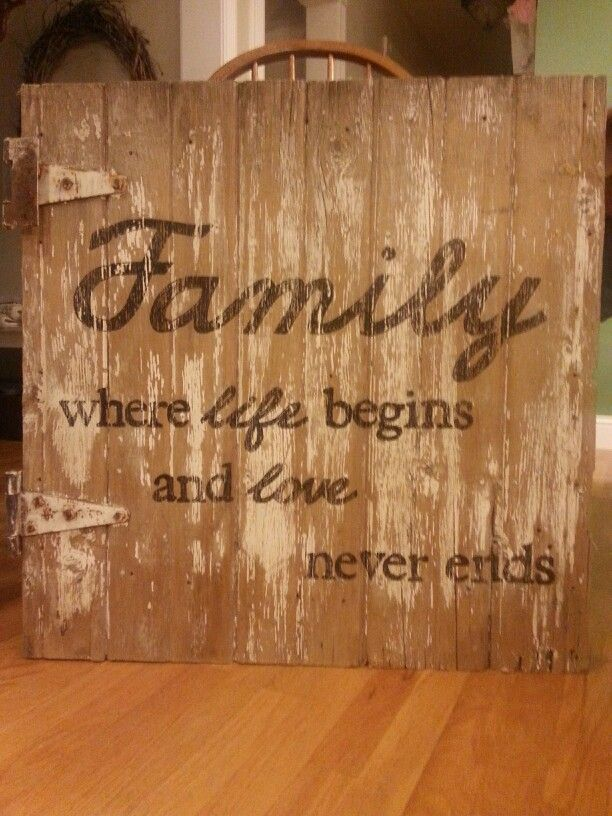 Old barn door with hand painted saying