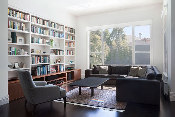 Lounge room joinery in solid grey ironbark timber and recycled Baltic pine timber floor | Glenderg Grove by Mihaly Slocombe (2015) | Malvern, Victoria, Australia | photo: Tatjana Plitt