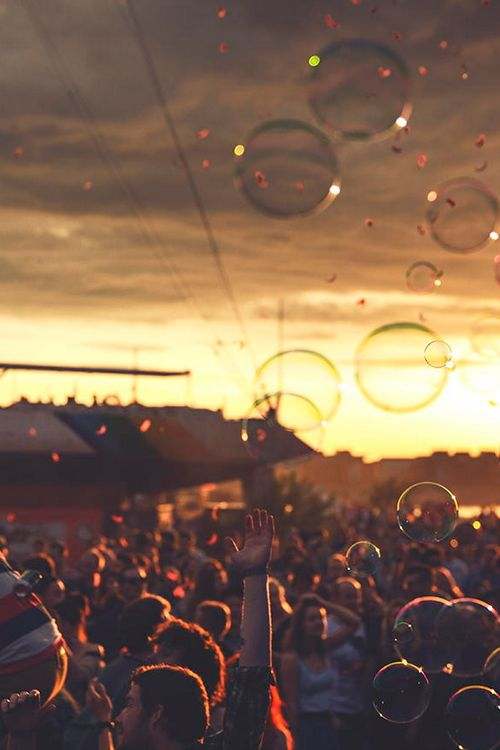 Sunlight, bubbles, festival crowd. Gosh I like this pic'!