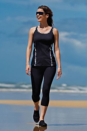 Black Mastectomy Sports Vest - this stunning spots vest is available is sizes 8-16.Now there are no excuses....  Exercise in confidence in this black with white detail sports vest, designed by Jamu Austrailia. Pocketed on both sides this sports top has great built in support and pockets on both sides and is suitable for medium impact exercise.  Where no specific cup size is stated, the swimsuit will fit a general up to a D cup size. If you take a DD cup fitting or larger, when ordering a…