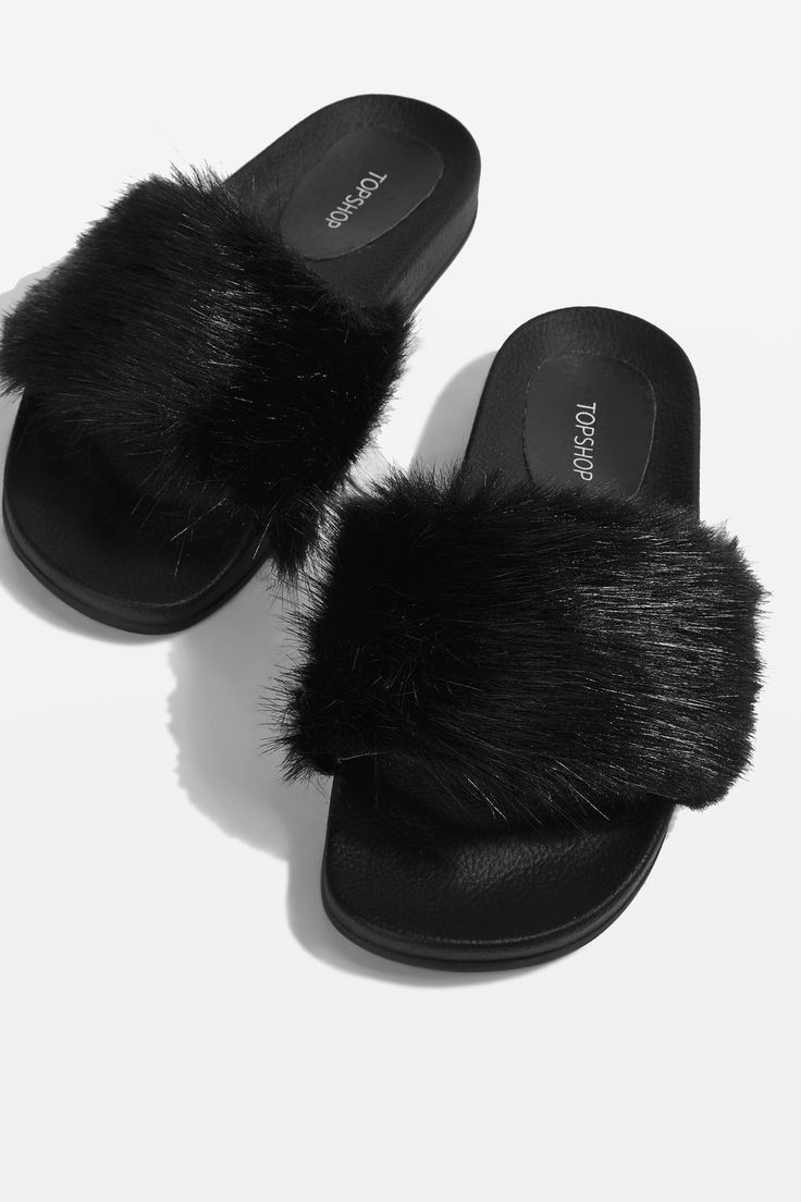 Black single strap fur sliders.