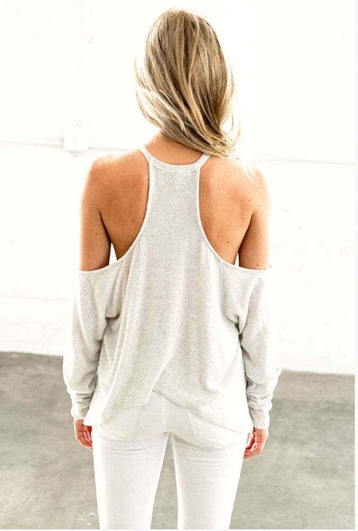 Sexy yet so sophisticated...this peekaboo shoulder top by Joah Brown goes from daytime to nite easily. Pair it with a lace bralette and skinnies or shorts. Throw it over your yoga outfit for a quick a