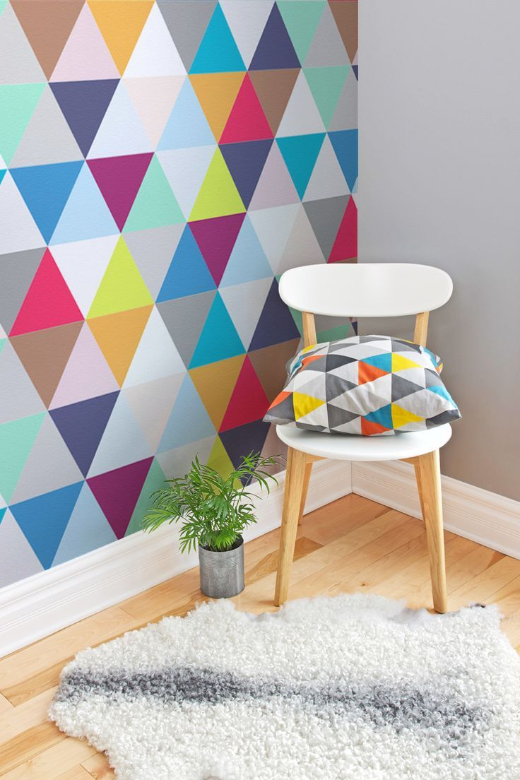 If you love geometric prints, you'll love this colourful wallpaper design. It makes a fun and quirky accent wall in the living room. Team with minimal furnishings to really make the wallpaper pop!