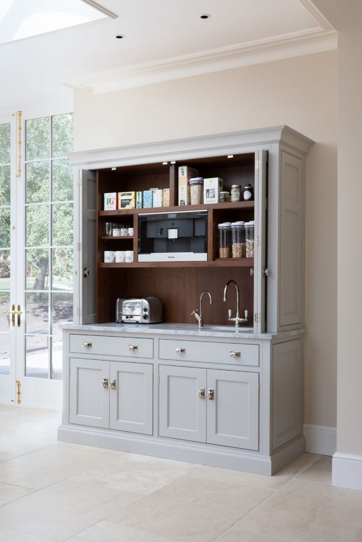 A Large Countertop Breakfast Cupboard With An Integrated