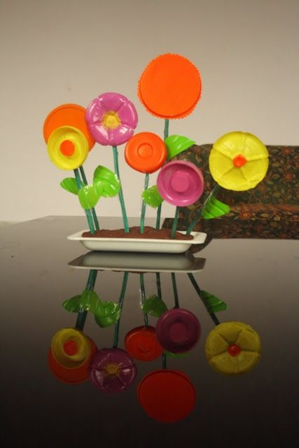 Craft ideas using bottle caps recycled crafts recycled for How to make bottle cap flowers