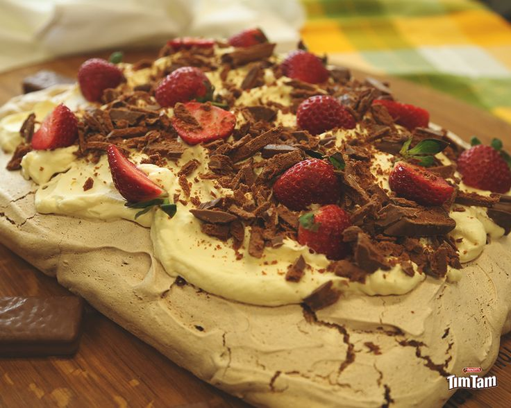 Chocolate Tim Tam Pavlova Preparation time: 25 minutes Cook time: 2 hours Serves: 8 Ingredients · 6 eggs, separated · 1 2/3 cup caster sugar · 1 tbs cocoa powder · 2 tsp cornflour · 1 ¼ tsp white...