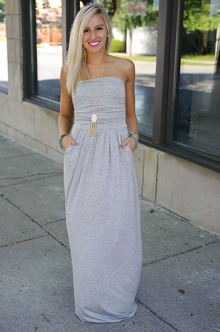 Grey strapless maxi dress with pockets.