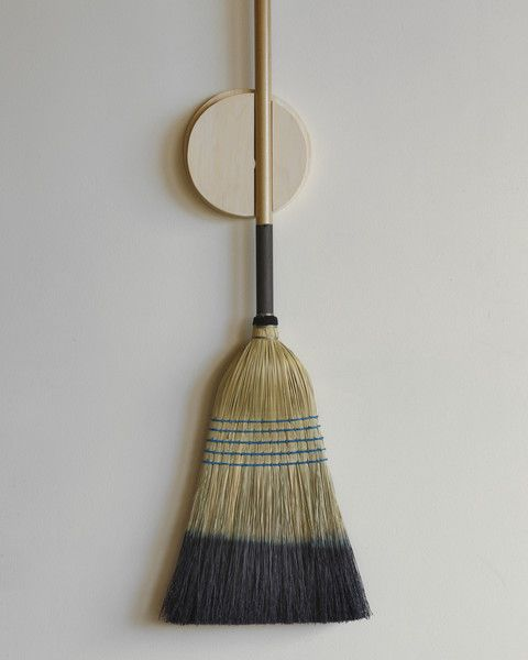 The Broom Holder keeps our Barn Broom in good shape for the next use while storing it neatly on the wall. The round puck inside holds the broom in place by creating tension with the opposite side when