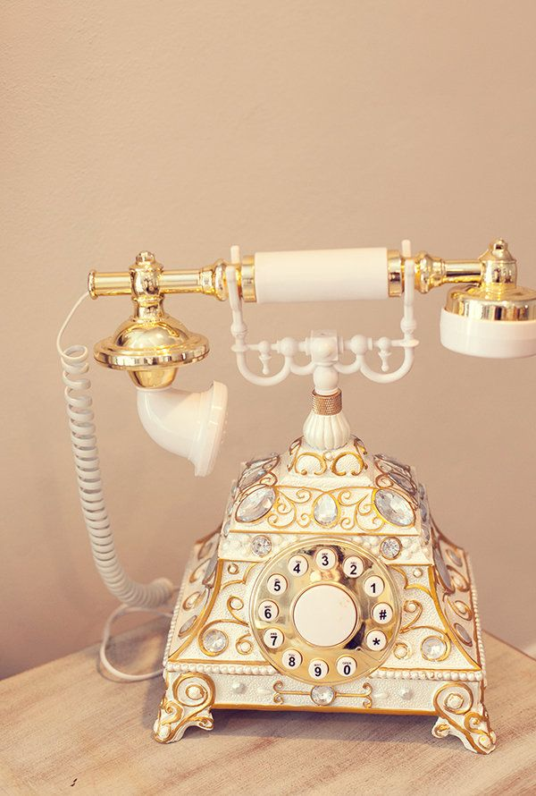 French Provincial style rotary dial telephone. (on closer look, it appears to be a push-button replica, but it's still pretty!)