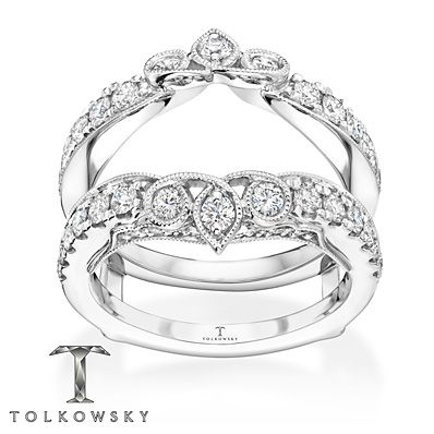 Loops of 14K white gold and trios of round diamonds perfectly frame her solitaire ring (sold separately) in this stunning enhancer ring by Tolkowsky®. More diamonds flow gracefully along the band, bringing the total weight to 1 carat. Diamond Total Carat Weight may range from .95 - 1.11 carats.