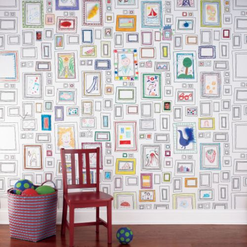 We're crazy about this wallpaper filled with blank picture frames that your kids can draw on. #art #playroom