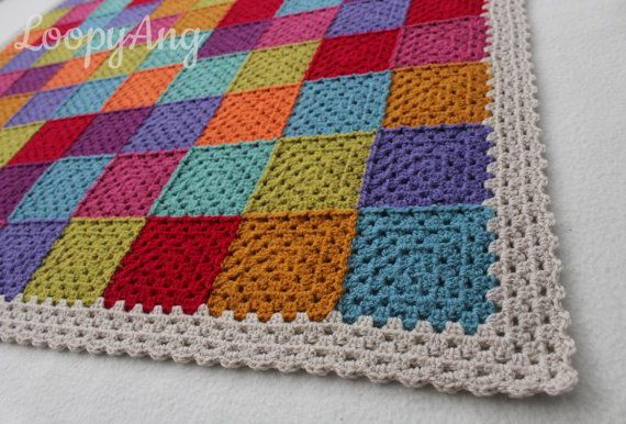 This patchwork style blanket/throw is perfect for snuggling up under both…