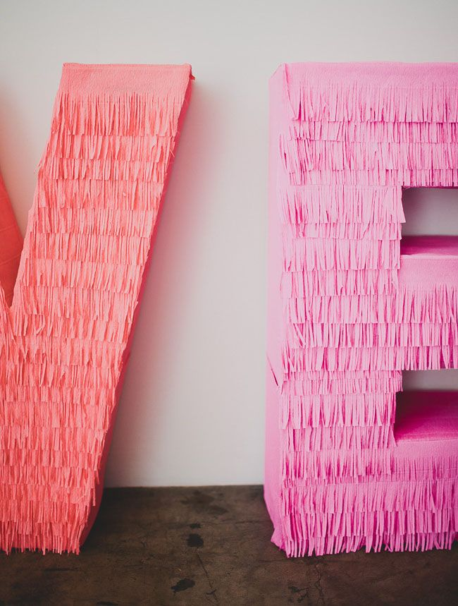 DIY Giant Fringe Love Letters for your reception decor!