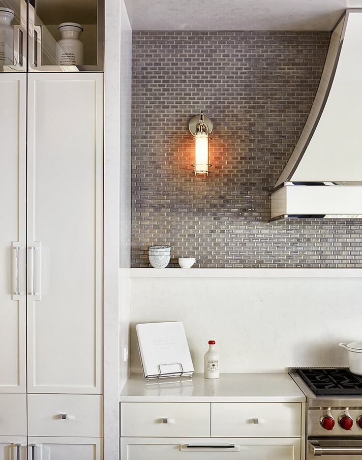 Gray mini brick backsplash, contemporary hardware, trim on hood