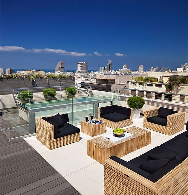 modern outdoor deck with beautiful patio furniture on the rooftop | The best rooftop design ideas for your home! See more inspiring images on our board at http://www.pinterest.com/homedsgnideas/rooftop-design-ideas/