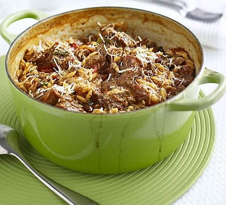 Greek lamb with orzo 1kg shoulder of lamb 2 onions , sliced 1 tbsp chopped oregano , or 1 tsp dried ½ tsp ground cinnamon 2 cinnamon sticks , broken in half 2 tbsp olive oil 400g can chopped tomatoes 1.2l hot chicken or vegetable stock 400g orzo (see know-how below) freshly grated parmesan , to serve