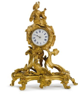 A LOUIS XV ORMOLU SMALL MANTEL CLOCK  CIRCA 1745.
