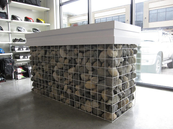 Retail Counters | Retail Design |  A contemporary bicycle shop; retail design by Hatch Interior Design Inc. in Kelowna, BC.  Innovative rock gabion style reception desk.